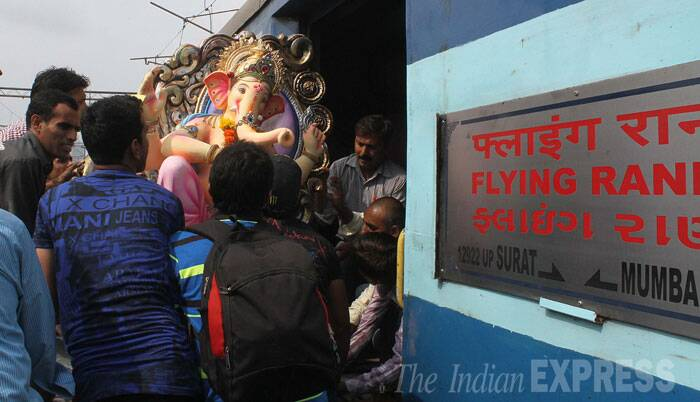 A Lord Ganesha Idol being taken to Surat for decoration on the Flying Rani train at Bombay Central. Ganesh Chaturthi begins from Friday (August 29). (Source: Express photo by Pradeep Kocharekar)