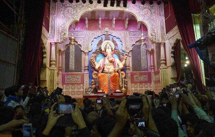 Artists across Maharashtra are busy toiling over Ganpati idols as the state celebrates the festival of Ganesh Chaturthi. In Mumbai, devotees arrive to get a glimpse of the of the Lalbaugcha Raja idol. (Source: PTI)