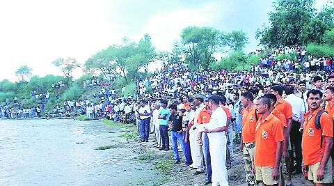 Locals watch rescue work after a boat capsized in Mirzapur on Tuesday; right: The rescue team. ( Source: PTI )