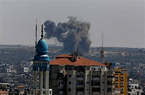 Smoke and dust rise after an Israeli strike hits Gaza City in the northern Gaza Strip. (Source: AP photo)