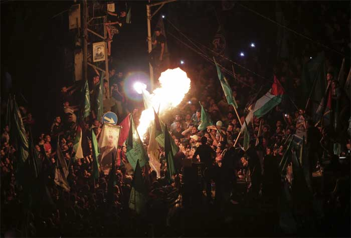 People familiar with the agreement said it would ease but not lift Israeli restrictions on travel and trade, largely reviving the terms of a 2012 ceasefire agreement that ended an eight-day air war.  In this pic, Palestinians perform fire works as they celebrate the ceasefire between Palestinians and Israelis at the main road in Gaza. (Source: AP)
