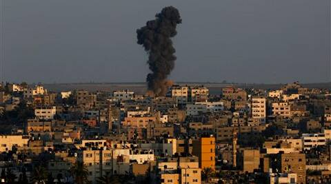 Smoke and dust rise after an Israeli strike hit Gaza City in the northern Gaza Strip, Tuesday, Aug. 19, 2014. The Israeli military said it carried out a series of airstrikes Tuesday across the Gaza Strip in response to renewed rocket fire. Source: AP photo