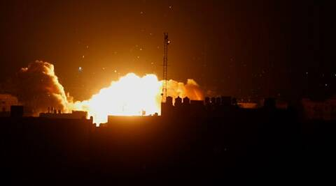 A ball of fire rises following an Israeli air strike on a building in Gaza, in the northern Gaza Strip. Source: AP photo