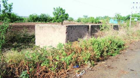 A Maryada Ghode, or wall of respect, the area behind which villagers use as a toilet. (Source: Express photo)