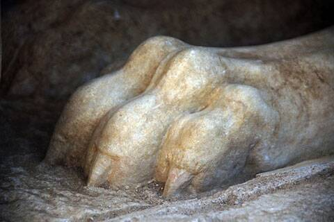 Front paw of a large stone sphinx is seen topping the entrance to the ancient tomb under excavation. (Source: AP)