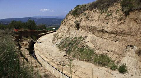 A partial view of the site where archaeologists are excavating an ancient mound in Amphipolis, northern Greece.  (Source: AP)