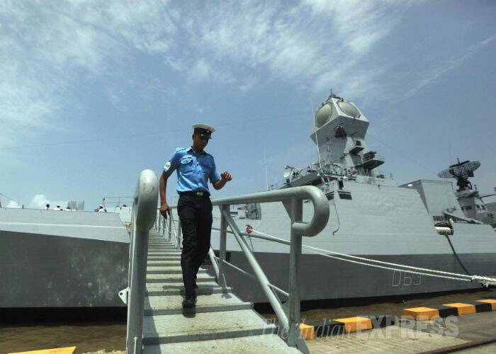 A navy officer is seen getting off from the INS Kolkata. (Source: Express Photo by Ganesh Shirsekar)