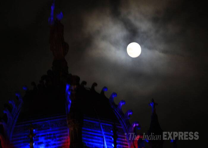 The supermoon is seen in Mumbai on a cloudy day. (Source: Express photo by Ganesh Shishekar)