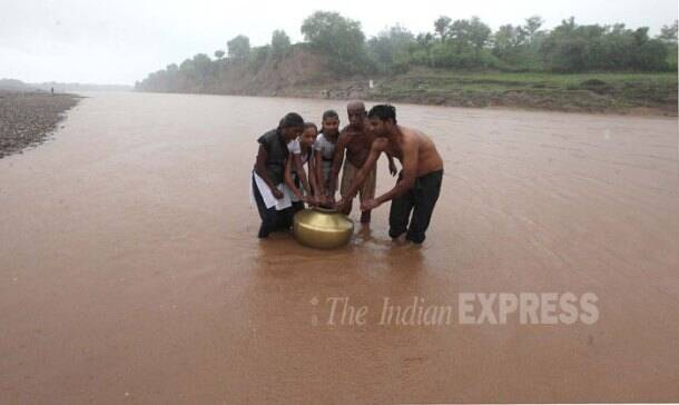 Gujarat kids swim daily to reach school