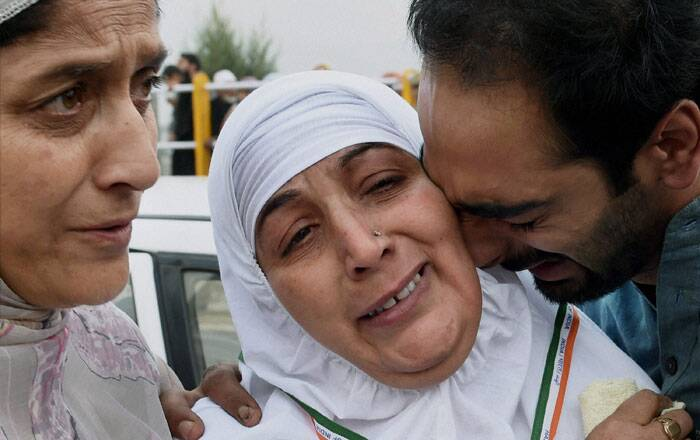 Two flights will carry pilgrims from Jammu and Kashmir to Saudi Arabia daily till the middle of September.<br /><br /> Relatives bidding an emotional farewell to a woman pilgrim outside Haj House Bemina in Srinagar. (Source: PTI Photo)