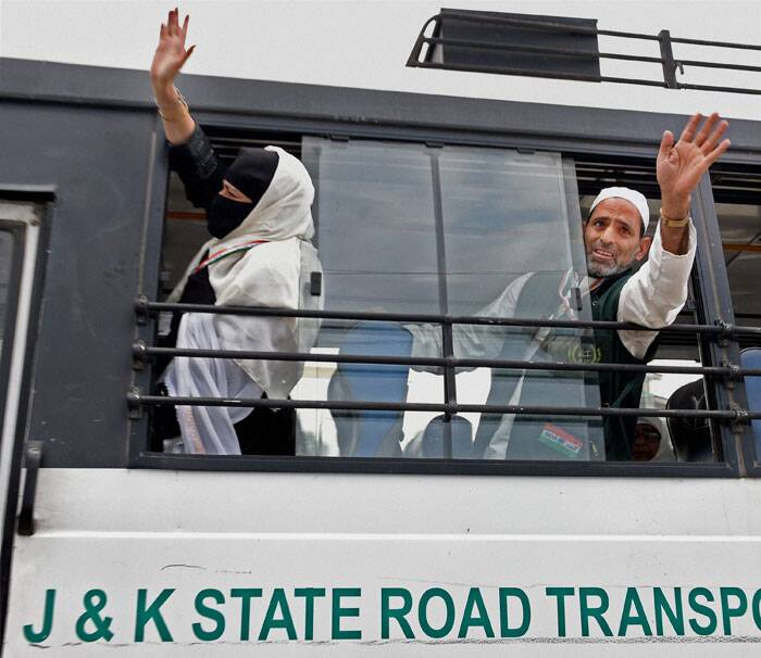 The 275 pilgrims boarded the Air India flight from Srinagar to Madina at the Srinagar International Airport on Wednesday morning.<br /><br /> Haj pilgrims wave at relatives from a bus outside Haj House Bemina in Srinagar on Wednesday. (Source: PTI Photo)