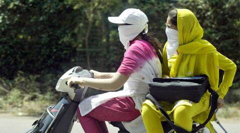 According to the earlier provision, it was optional for the women pillion rider to wear helmet. (Source: AP photo)