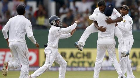 Rangana Herath (top) celebrates with Angelo Mathews, Mahela Jayawardene (R), Kaushal Silva (2nd L) and Lahiru Thirimanne after taking the wicket of Asad Shafiq during the second and final Test in Colombo. (Source: Reuters)