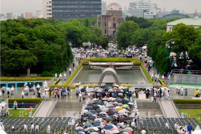 About 45,000 people stood for a minute of silence at the ceremony in Hiroshima's peace park near the epicenter of the 1945 attack that killed up to 140,000 people. A second bombing, over Nagasaki three days later, killed another 70,000, prompting Japan's surrender in World War II.<br /><br /> People wait in queue to offer prayers for the victims of the 1945 atomic bombing, in the rain at the Peace Memorial Park in Hiroshima, in this photo taken by Kyodo August 6, 2014, on the 69th anniversary of the world's first atomic bombing.   (Source: Reuters/Kyodo)
