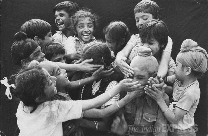 In this 1986 file photo, children are seen playing Holi. (Express archive photo)