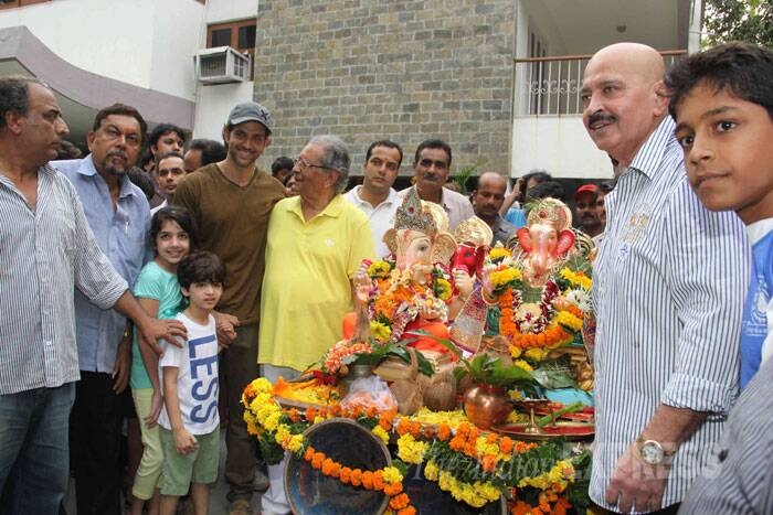 Hrithik Roshan is seen with his father Rakesh Roshan, maternal grand father J Omprakash and son Hridhaan. (Source: Express photo by Varinder Chawla)