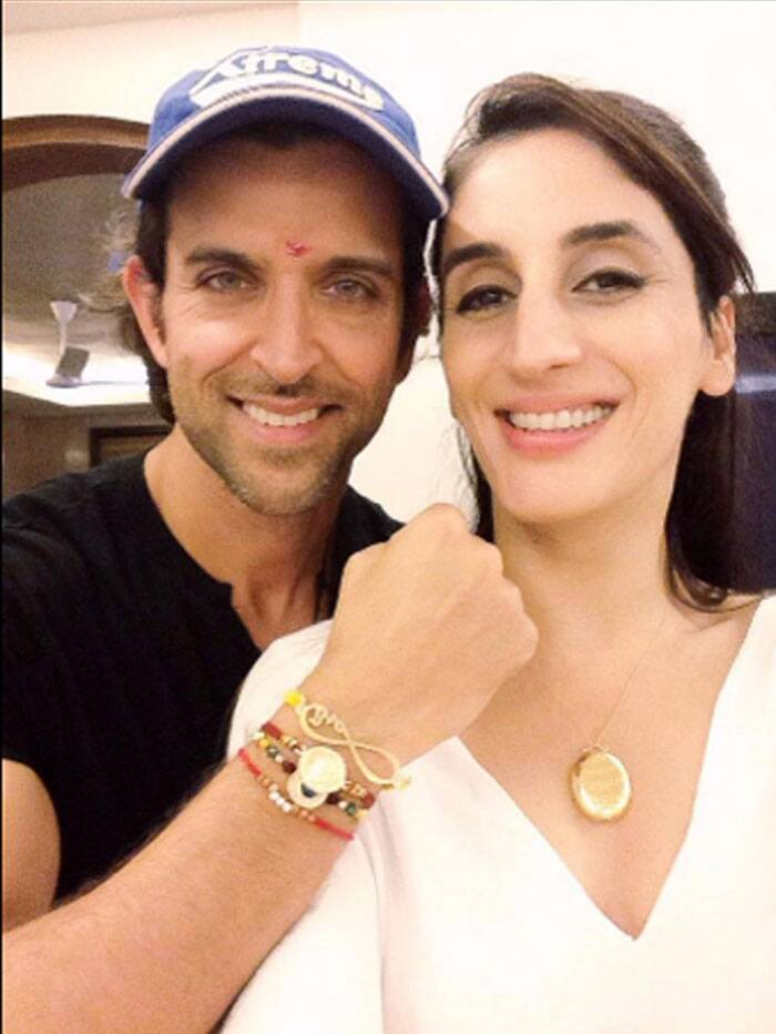 "Hrithik Roshan, who has separated from wife Sussanne last year, was seen celebrating rakhi at her home. Sussanne's sister and jewellery designer Farah Khan Ali ties rakhi to Hrithik. Tweeting a picture of the two, Farah wrote: ""With my younger brother @iHrithik . Love you Duggu. #Rakshabandhan #Family.""  (Source: Twitter)"