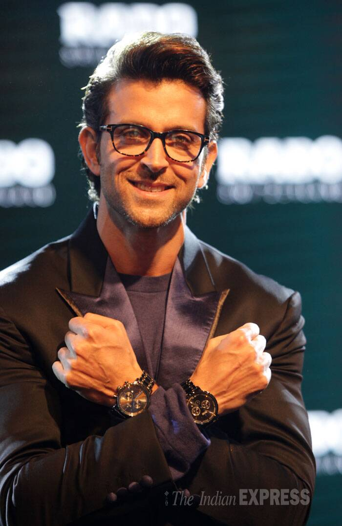 Hrithik looks thrilled with his watches. (Source: Express photo by Amit Mehra)