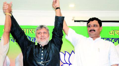 Former CPM member industrialist Sishir Bajoria (left) with BJP state president Rahul Sinha on Saturday.