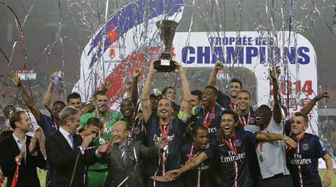 Ibrahimovic (C) raises the trophy as he celebrates with his teammates after winning against Guingamp. (Source: Reuters)