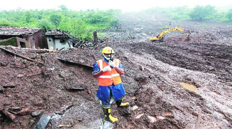 An NDRF member coordinates the rescue operation, six days after the tragedy. Police have roped in members of the local panchayat for help.  ( Source: Express photo by Pavan Khengre )