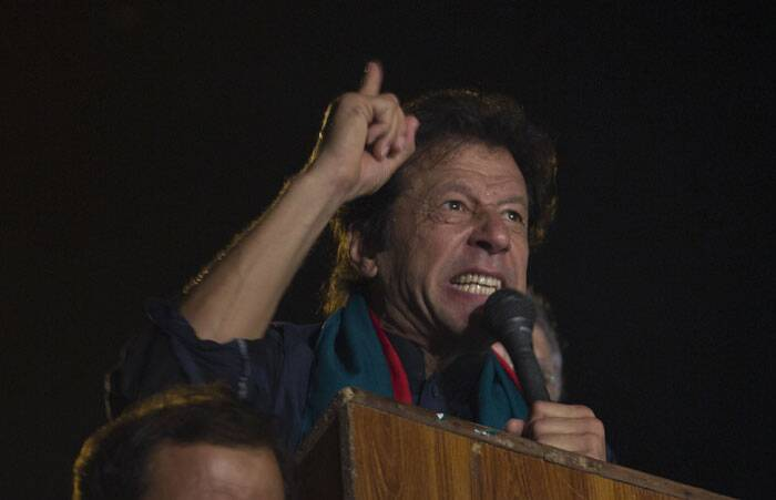 Pakistan's cricketer-turned-politician Imran Khan motivates his supporters to march to Parliament House in Islamabad. (Source: AP)