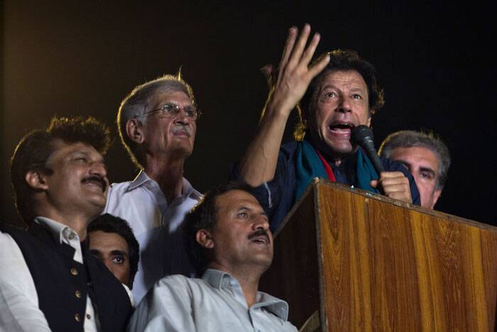 Pakistan's cricketer-turned-politician Imran Khan delivers a speech to his supporters urging them to march to Parliament in Islamabad. (Source: AP)