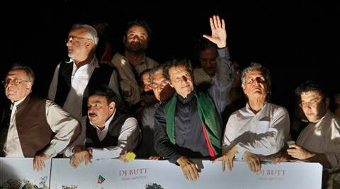 Pakistan's cricketer-turned-politician Imran Khan waves to supporters as he leads a march toward parliament in Islamabad, Pakistan. Source: AP photo
