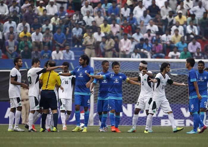 The players argue with the referee as the home team didn't quite agree with a decision given by the official. (Source: PTI)