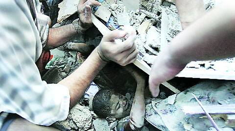 A Palestinian boy being rescued from under the rubble of a house in Rafah in the southern Gaza Strip. ( Source: Reuters )