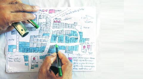 A police officer redraws the route for kanwarias to avoid the mosque in Saharanpur. Express Photo by Source: Oinam Anand)