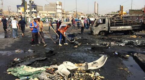 Baghdad municipality workers clean the site of a car bomb explosion in a commercial area of New Baghdad, Iraq, Tuesday, Aug. 26, 2014. (Source: AP)
