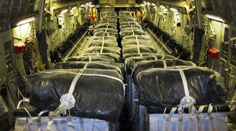 This image provided by the U.S. Defense Department shows pallets of bottled water are loaded aboard a U.S. Air Force C-17 Globemaster III aircraft in preparation for a humanitarian airdrop over Iraq. Source: AP Photo