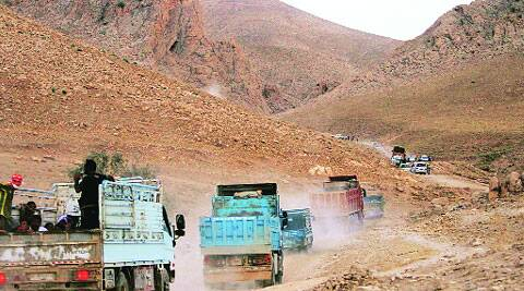 Displaced Yazidis ride trucks as they are evacuated from Mount Sinjar in Iraq Thursday. ( Source: Reuters )