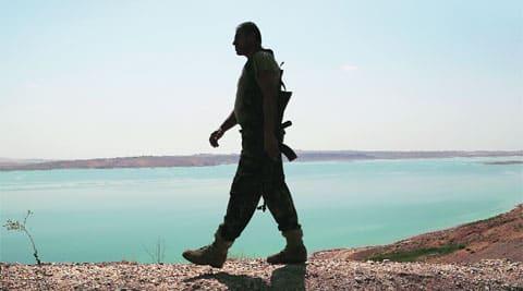 A Kurdish peshmarga fighter patrolling near Mosul dam.  (AP)