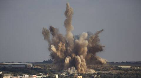 Smoke rises in Gaza City after an Israeli airstrike Saturday, Aug. 9, 2014. (Source: AP)