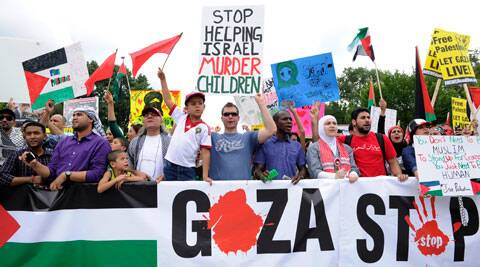 Demonstrators rally to end violence in Gaza near the White House in Washington on Saturday. (Source: AP)