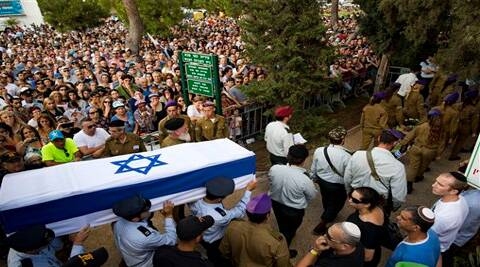 Israeli soldiers carry the coffin of Israeli Army 2nd. Lt. Hadar Goldin during his funeral at the military cemetery in the central Israeli city of Kfar Saba on Sunday. ( Source: AP )