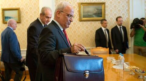 Palestinian negotiator Saeb Erekat, center, arrives for his and Russian Foreign Minister Sergey Lavrov talks in Moscow, Russia. Source; AP photo