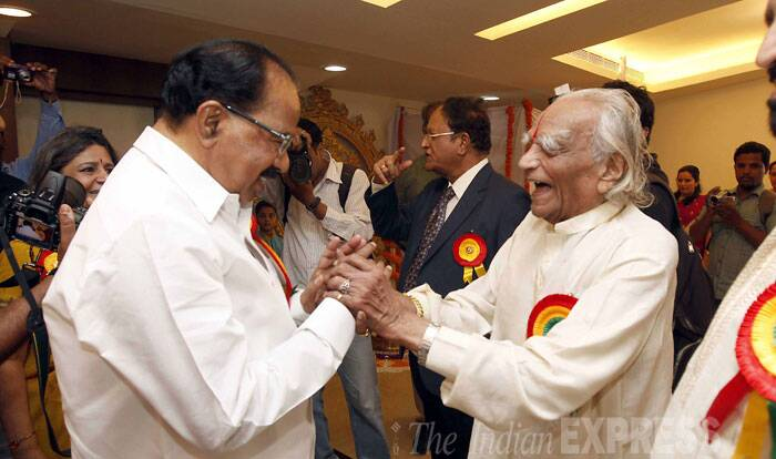"An eminent exponent of yoga as enunciated in the ancient ""Patanjali Sutra"", Iyengar was credited with spreading practice of yoga to about 60 countries which he visited carrying message from the east to the west.   <br /><br /> File Photo: Former union minister Veerappa Moily greets BKS Iyengar, one of the foremost yoga teachers in the country during public function at Kannada Sangha's Kaveri Group of Institutes in Eranadwane area. (Source: Express Archive Photo by Pavan Khengre)"