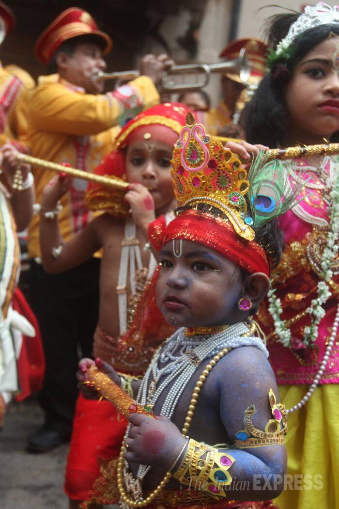 Kids dressed as lord Krishna takes part in a programme during the celebration of Janmashtami festival in Beliaghat North Kolkata on Sunday. (Source: Express photo by Partha Paul)