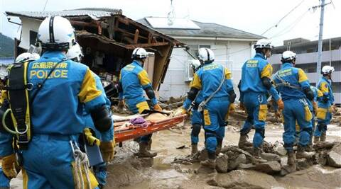 A troop of police rescue personnel head out for rescue operation after a massive landslides swept through residential area in Hiroshima, western Japan, Wednesday. (Source: AP photo)