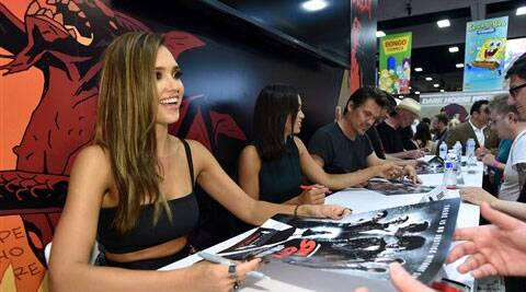 "Jessica Alba, and from left, Rosario Dawson, Josh Brolin, director Robert Rodriguez and writer/director Frank Miller attend the ""Sin City: A Dame to Kill For"" signing on Day 3 of Comic-Con International on Saturday, July 26, 2014. (Source: AP)"