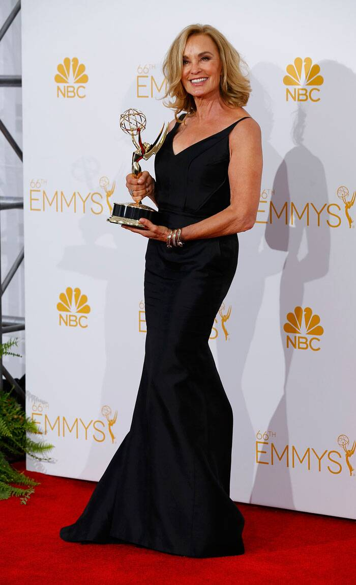 Jessica Lange from 'American Horror Story' smiles as she poses with her Emmy for Outstanding Lead Actress in a Miniseries or Movie award. (Source: Reuters)