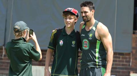 Mitchell Johnson poses with a fan a day before the tri-series in Harare. ( Source: AP)