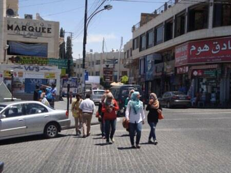 Women in Amman wear colourful headscarves over jeans, trousers, and full-length skirts (Source:  Irena Akbar )