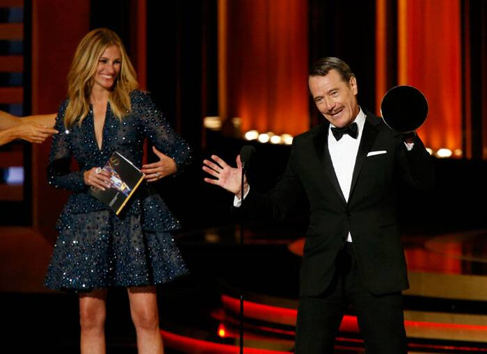 "Julia Roberts beams as she allows 'Breaking Bad' lead actor Bryan Cranston steal the spotlight on the stage. <br /><br /> Bryan Cranston was honored as best actor in a drama for ""Breaking Bad,"" proving that ""True Detective"" nominee Matthew McConaughey's movie-star appeal couldn't conquer all. (Source: Reuters)"