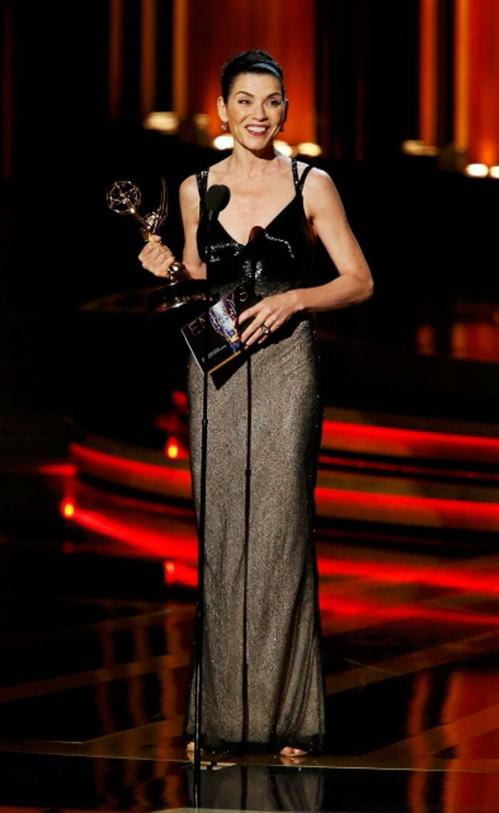 Julianna Margulies takes the mic onstage after accepting the Emmy for  Outstanding Lead Actress In A Drama Series for her role in 'The Good Wife. (Source: Reuters)