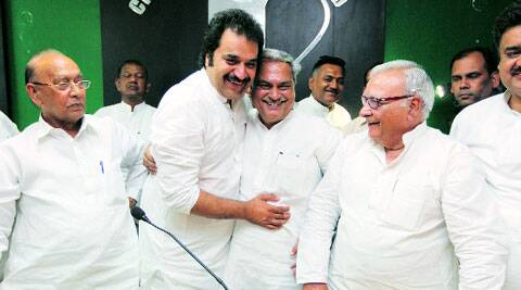 Kuldeep Bishnoi with Venod Sharma in Chandigarh on Thursday.