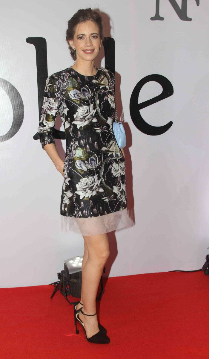 Kakli Koechlin was girly and feminine in a floral-print Dior dress with a sheer hem and blue Dior bag. Ankle-strapped heels and an elegant hairdo let the dress do the talking. (Source: Varinder Chawla)
